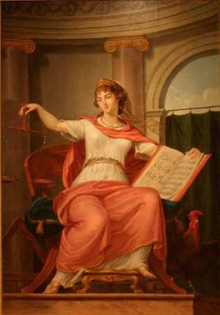 "Bernard d'Agesci (1757-1828), La justice, musée de Niort. Holds scales in one hand and in the other hand a book with ""Dieu, la Loi, et le Roi"" on one page and the Golden rule on the other page."